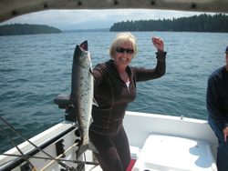 This is a picture of Arlene with first ever salmon.  She was very excited  and picked this Chinook at Kirby Point   Arlene from Calgary Alberta fished with John of Slivers Charters