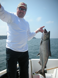 This is Mansel  in the attachment   He is from Calgary and picked up this 23 pound Chinook at Edward King in Barkley Sound Guide was John of Slivers Charters Salmon Sport Fishing