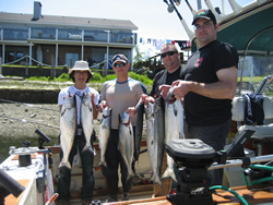 Taja Steve Mark and Leigh show their catch of salmon caught out at the Big Bank off of Ucluelet Guide was Alan   this was the first trip for this Vancouver B.C. group