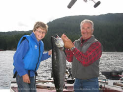 Guide Mel of Slivers Charters Salmon Sport Fishing with his young guest from Alberta show off their great Chinook.  This was this young boys first ever salmon