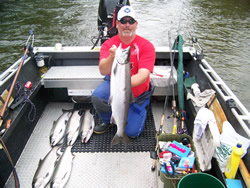 Guide Nick displays six Coho landed by Florida guests recently fishing the Stamp River