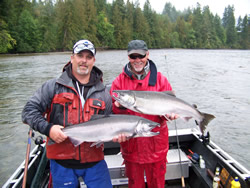 Guide Nick and guest Ken show off two of their bright silver salmon picked up in the Stamp river.   These fish were landed below