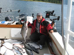 Yuepeng shows his catch of fall salmon and halibut that he caught with friends of the shore of Ucluelet.  Yuepeng was so thrilled with this fishing trip that he and his friends have booked three days of fishing in 2010