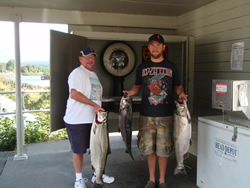 Father and son Tom and Scott show off some of their catch at the Port Alberni, Clutesi Haven Marina weighing station.  Fishing trip in Barkley Sound and the Port Alberni Inlet for the Vancouver men was great. As Tom and Scott and brother Peter explained