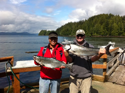 Great day of fishing on the surfline of Barkley Sound.  These Chinook were in tight to the surfline and were picked up at the fifty foot mark using anchovy in a chartreuse and green glo Rhys Davis Teaser head behind green and chartreuse hotspot flashers.  John of Vancouver is happy about his two salmon