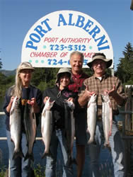 Summer sockeye fishing in the Port Alberni Inlet should be even better in 2010.  The 2009 season was spectacular.  Family from Arizona show some of their catch from July in 2009.  Guide Mel of Slivers Charters Salmon Sport Fishing is in the background.