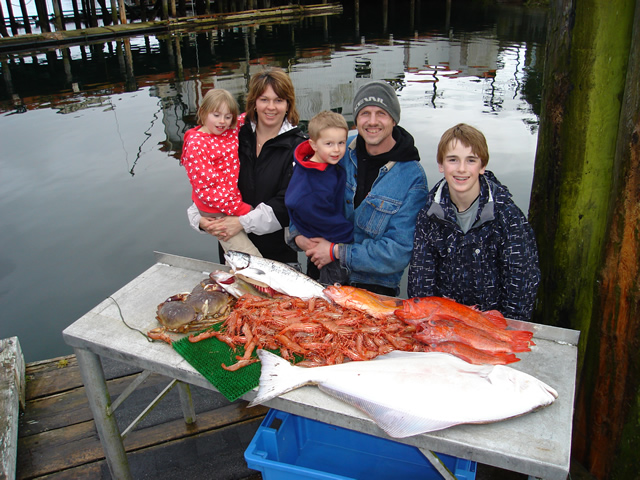 This is a family from Alberta   the Thompsons'   who experienced a great Seafood Safari Day The halibut and rockfish and salmon were caught a few miles out from Ucluelet  The prawns and Crabs were picked up in Barkley Sound close to Mayne Bay.   Guide was Mike Marriott.