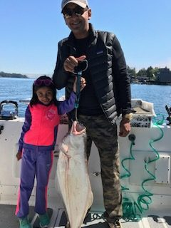Rahul and daughter from Nevada have a nice halibut and Chinook landed outside of Ucluelet.