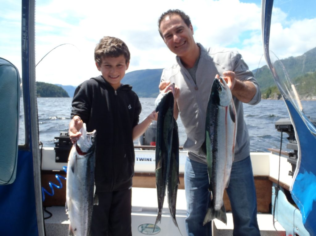 Sockeye salmon fishing in the Alberni Inlet can be an excellent family outing.  Ron and son from Vancouver show their Sockeye salmon landed in the Alberni Inlet.  It is hoped that returns to the Somass River will be strong enough to continue a sport fishery into July